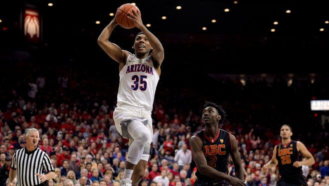 Arizona guard Allonzo Trier shoots in front of Southern California guard Jonah Mathews during the second half at McKale Center in Tucson. Arizona won 90-77.