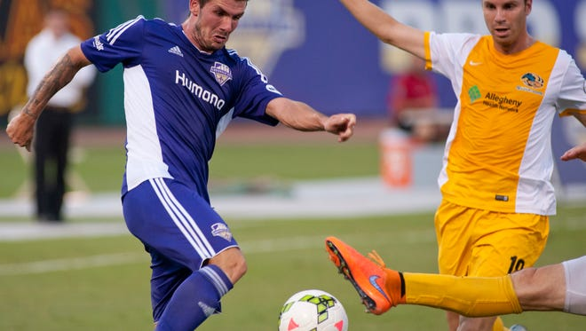 Louisville City FC midfielder Niall McCabe tries to score a goal. Watching the play is Pittsburgh (Pa.) Riverhounds midfielder Boris Zivanovic, right. 29 Aug 2015