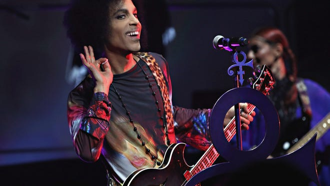 """Cindy Ord,  Getty Images, for NPG Records 201 TORONTO, ON - MAY 19:  (Exclusive Coverage) Prince performs onstage with 3RDEYEGIRL during their """"HITnRUN"""" tour at Sony Centre For The Performing Arts on May 19, 2015 in Toronto, Canada. (Photo by Cindy Ord/Getty Images for NPG Records 2015) ORG XMIT: 555109815 ORIG FILE ID: 474082364"""