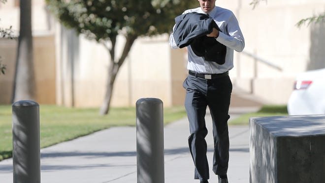 Former UTEP student Michael Karpus, 26, sprints Friday morning into the U.S. Federal Courthouse in El Paso, where he pleaded guilty in a gambling ring while at the university.