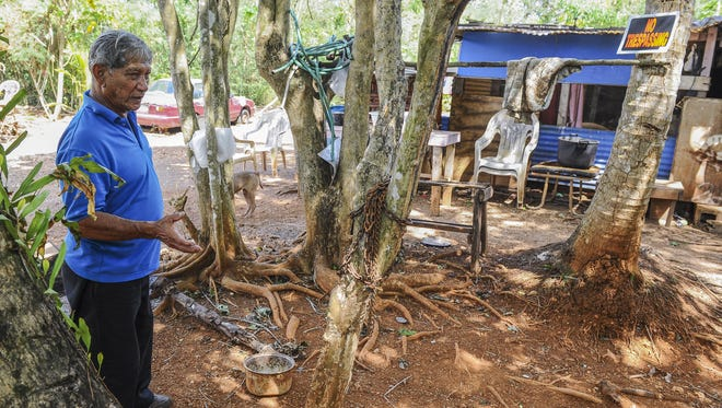 """In this file photo, Mangilao Mayor Nonito """"Nito"""" Blas explains why he had to evict migrants who were living on private property in his village"""