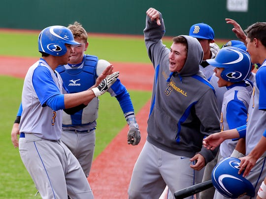 Bloomfield's Saul Noriega is congratulated by teammates after his home run against Taos on Saturday at John Gutierrez Field.