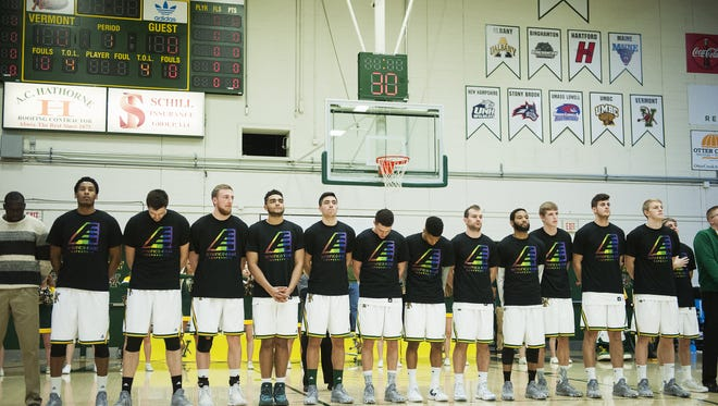 Vermont listens to the National Anthem during the men's basketball game between the Maine Black Bears and the Vermont Catamounts at Patrick Gym on Wednesday night.