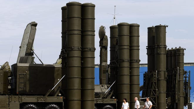 A file picture dated Aug. 14, 2014 of Russian anti-aircraft missile systems S-300, right, and S-400, left, on display at a military industrial exhibition in the city of Zhukovsky, Moscow .