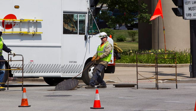 Teams from the Milwaukee Fire Department and WEC Energy Group responded to smoke rising from potholes near the Wisconsin Center.