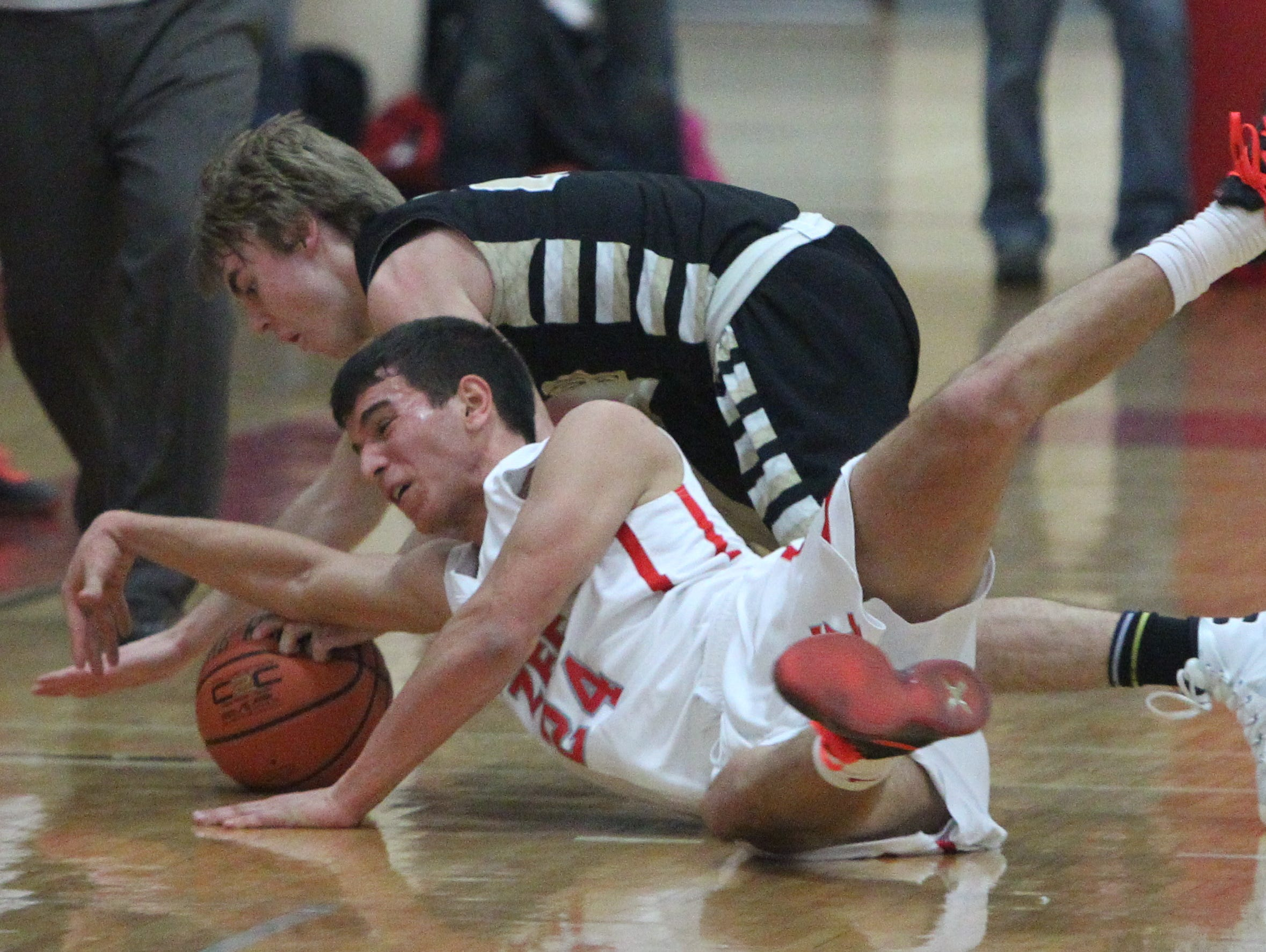 Tappan Zee's Rob McWilliams fights for a loose ball with Nanuet's Terence Rogers during their game at Tappan Zee Jan. 4, 2016. Tappan Zee won 59-46.