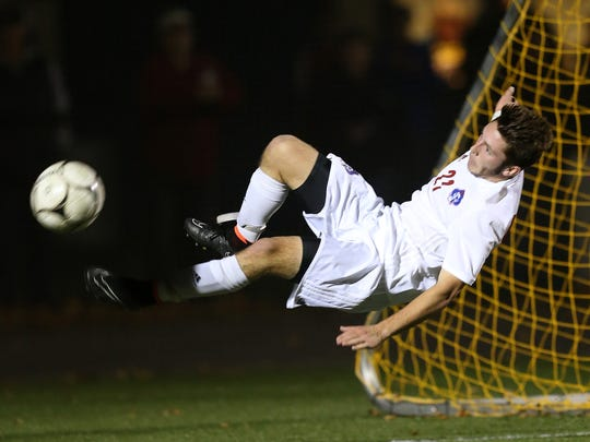 Fairport's Pete Critchlow can't connect on this bicycle kick against Thomas.