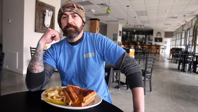 Owner Dustin Aguillard is pictured Tuesday, February 24, 2015, at Acadiana Grilled Cheese Co. in Lafayette, La.