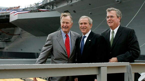 George H.W. Bush, George W. Bush and Jeb Bush are seen