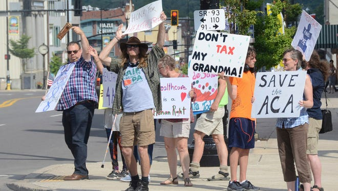 A group of protestors gather in front of Republican Rep. Lou Barletta's office in Hazleton, Pa., to protest the GOP's attempt to reform the health care system in July.