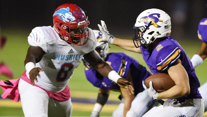 Sanger running back Gavin Brown (2) tries to stiffarm  Wichita Falls defensive lineman Tory Temple (8) during their game Friday October 13, 2017, at Indian Stadium in Sanger, Tx. Photo by Al Key/For the DRC