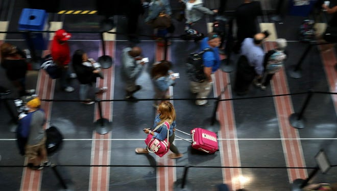 Travelers move through one of the Transportation Security Administration lines at Ronald Reagan National Airport's Terminal B and C Sept. 1, 2017 in Washington.