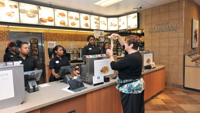 New employees are trained on the cash registers at Chick-fil-A in Brookfield before the store opened in 2016.