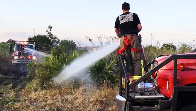 The Lehigh Fire and Rescue department puts out a one-acre brush fire Sunday near a home at the intersection of 57th Street West and Ida Avenue North in Lehigh Acres. No one was hurt or were homes damaged.
