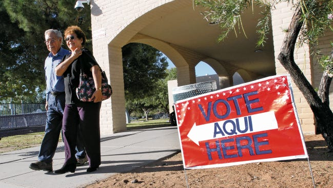 Voters walk out of the Carolina Recreation Center after casting their ballots.