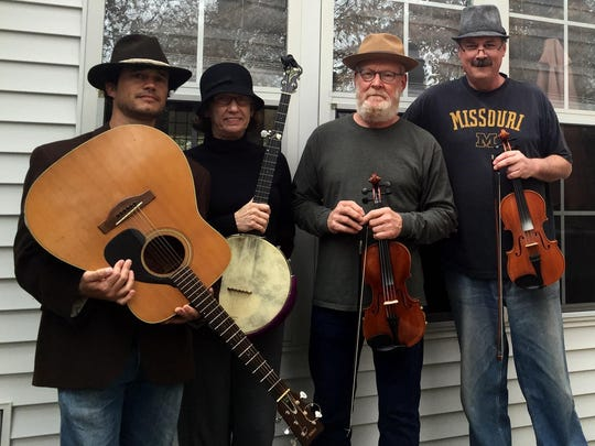 The Magnolia Hillbillies play for the monthly Contra