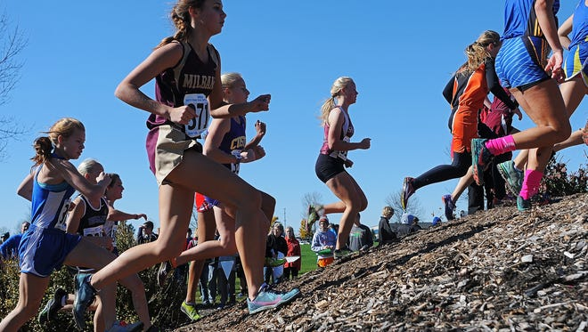 Runners participate in the Girls Class A race during the South Dakota State Cross Country Meet Saturday, Oct. 24, 2015, at Yankton Trail Park in Sioux Falls.