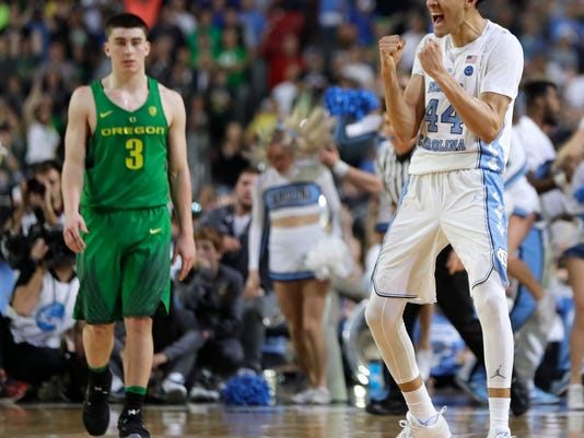 North Carolina forward Justin Jackson (44) celebrates in front of Oregon guard Payton Pritchard (3) at the end of a semifinal in the Final Four NCAA college basketball tournament, Saturday, April 1, 2017, in Glendale, Ariz. North Carolina won 77-76. (AP Photo/Mark Humphrey)