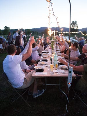 Diners toast the chefs and volunteers at Spring Kite Farm in Fort Collins during a previous Secret Supper.