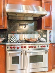 The home features three gourmet kitchens.