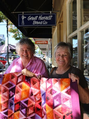 From left, Leslie Coleman Zeigen and Janet McLeod chatted up the 8th annual quilt show at the Willamette Heritage Center this weekend.