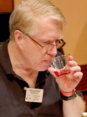 Judge, Doug Vohden, of Summit, takes a sip of beer during the Motown Mash home-brew competition which was held at Nicole's Ten. Hundreds of home-brewed beers were judged by the Morris Area Society of Homebrewers. The event was held November 7, 2015 in Randolph.