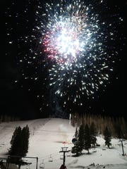 Fireworks lit up the sky at Ski Apache during the Torchlight