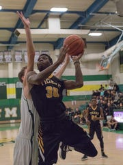 Alamogordo's Carlton Bartley drives to the hoop in