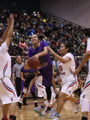 Kirtland Central's Haile Gleason drives past Shiprock's Tia Woods for a layup in the third quarter on Friday night at the Chieftain Pit.