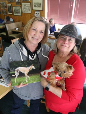 From left, Terri Jacobson and Terri Ellen and her dog Tillie came down to talk about a fundraiser to help Jacobson's dog Pete who has bone cancer.