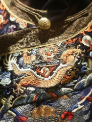 Detail of a robe given to Gen. Claire Chennault by the last emperor of China for his work training pilots to help protect the country against the Japanese invasion during World War II. Embroidered robes like the one on display in the exhibit would have taken about eight years to make, Alex Powell, the museum's public relations officer, said.
