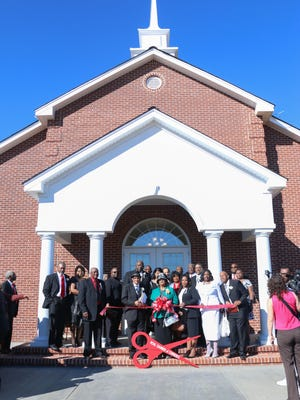 The Rev. Carl Burkett and deacons prepared to cut the ribbon at Mount Vernon Missionary Baptist Church in Petal.