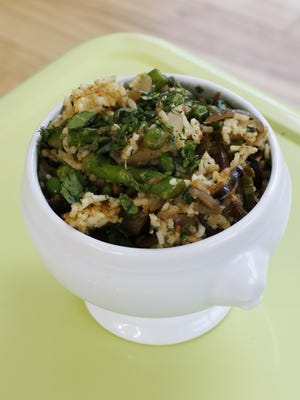 The combination of rice packed with spiced fennel, onions and garlic cooked slowly until soft and finished with still-crisp asparagus and peas makes for a perfect spring dish.