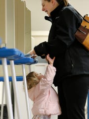 Brenna Davie, 2, asks for attention from her mother,