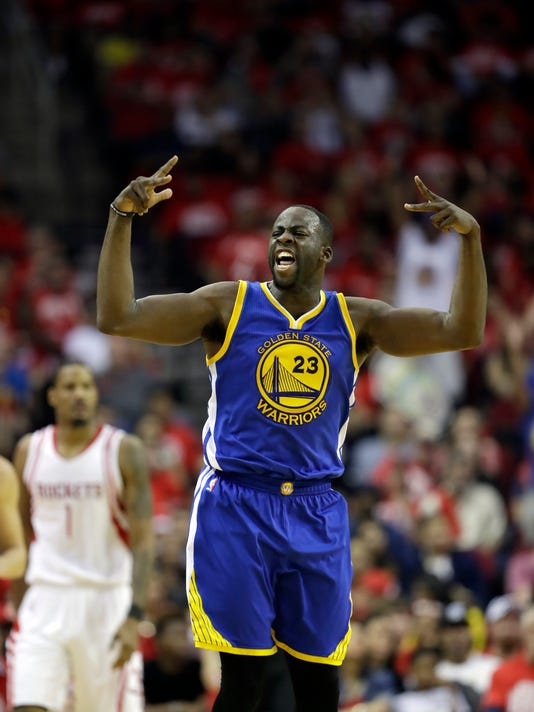 Golden State Warriors' Draymond Green reacts after hitting a 3-point shot during the second half in Game 4 of a first-round NBA basketball playoff series against the Houston Rockets, Sunday, April 24, 2016, in Houston. (AP Photo/David J. Phillip)