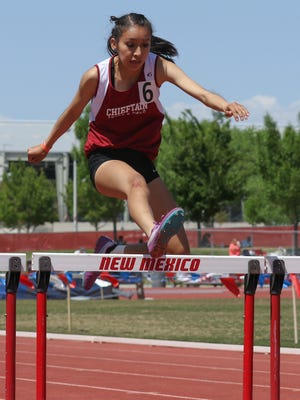 Shiprock's Kylie McKinley clears the final hurdle in the girls 4A 300-meter hurdles on Friday at the University of New Mexico Track & Field Complex in Albuquerque.