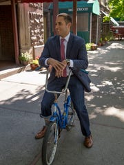 Ithaca Mayor Svante Myrick stopped by the breakfast station outside the DeWitt Mall on Friday. He tried out the banana seat cruiser.