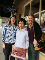 Leslie McMillan, left, Gretchen Bennett, and a family friend from Kyrgyzstan, came by to invite the public to a lecture series about some of the languages spoken in the Mid-Valley.