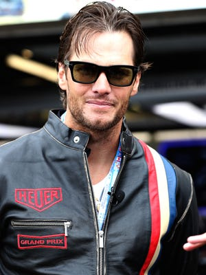 New England Patriots star Tom Brady stands in pit lane ahead of the Canadian Formula One Grand Prix on June 12, 2016, in Montreal.