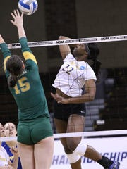 Tulani Titley of Angelo State goes up to spike the