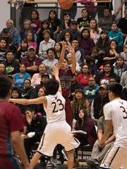 Shiprock's Landon Henderson shoots a 3-pointer over Navajo Prep's Trejan Clichee in the fourth quarter on Friday at the Eagles Nest in Farmington.