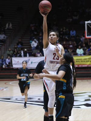 Shiprock's Tanisha Begay shoots over Navajo Prep's Chantel Wagner on Tuesday during their 4A quarterfinal game in Albuquerque.