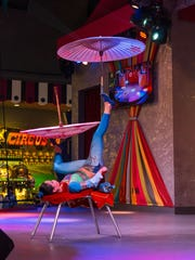 The stage shows at the Midway feature clowns, acrobats and artists.