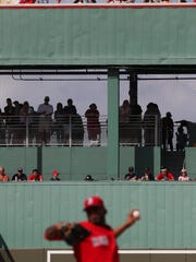 Crowds line the green monster as they watch the Boston Red Sox and New York Mets play at JetBLue Park during a spring training game on February 24, 2017.