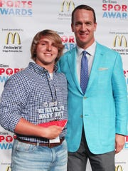 Peyton Manning poses with the Male Powerlifting Player of the Year Award winner Jack Tyndall (Calvary) at the Shreveport Times Sports Awards at the Shreveport Convention Center in Shreveport, Monday, May 15, 2017.