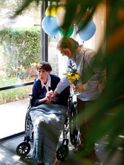 Sarah Victoria Shivers Davidson, left, speaks with her niece, Carolyn Katterjohn, as she celebrates her 109th birthday at Lakeland Health Care Center in Jackson Friday.