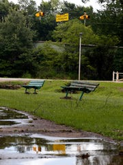 Water covers the cart path of the nine-hole Grove Park