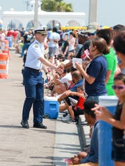Captain Tony Hahn greets the parade goers during the Mayor's Big Bang Parade on North Shoreline in Corpus Christi, Texas on Monday, July 4, 2016.