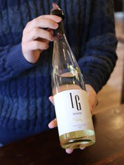 IG Winery Marketing Manager Tony Piersanti holds a