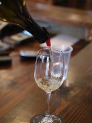 IG Winery Marketing Manager Tony Piersanti pours wine